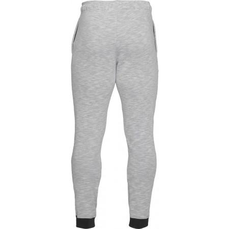 Spodnie dresowe męskie - Under Armour BASELINE TAPERED PANT - 2