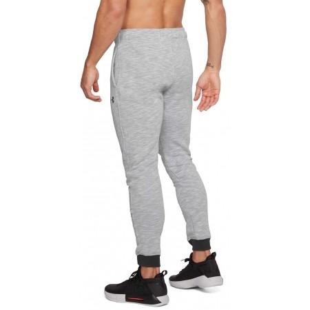 Spodnie dresowe męskie - Under Armour BASELINE TAPERED PANT - 5